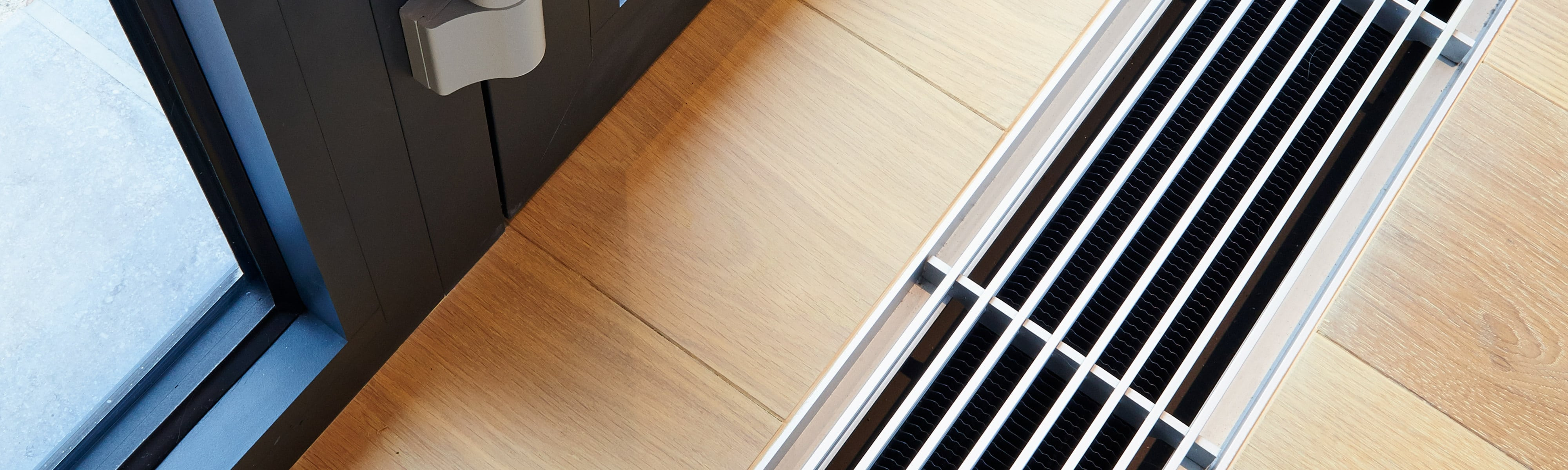An air vent on a wooden floor.