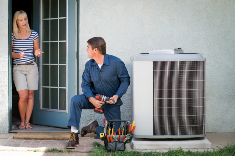 technician talking to homeowner about FAQs about the new AC regulations
