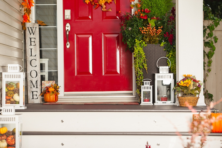 front door fall decorations representing the reasons to schedule a furnace clean and check