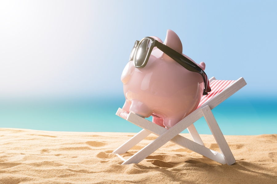 Piggy bank on the beach representing the financing options for how you can afford a new AC system or other HVAC equipment.