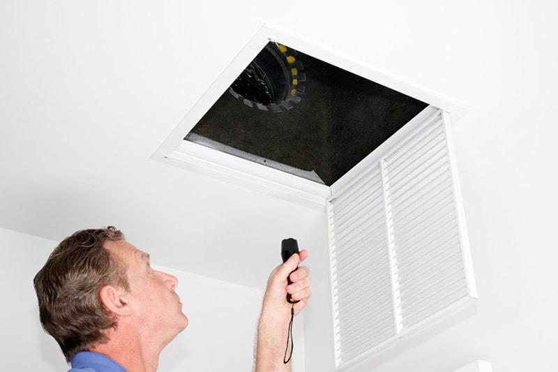 Man Looking at HVAC System