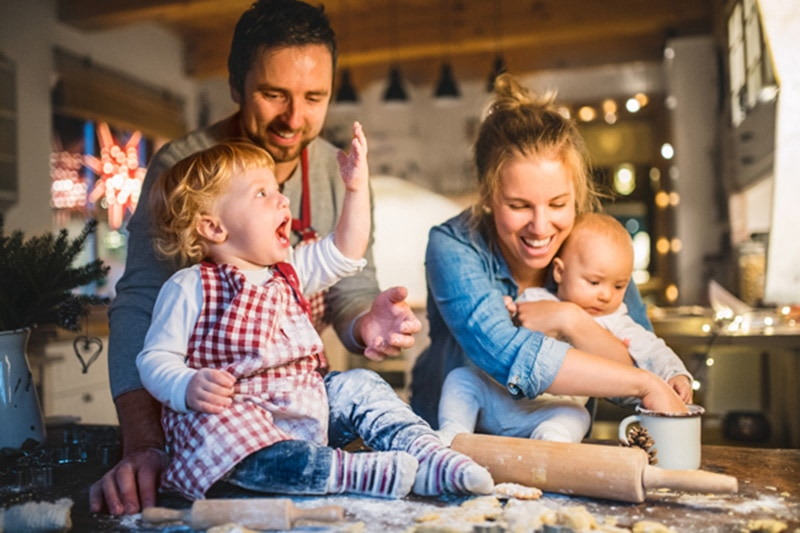 happy family of four baking together at home, Ways Your Furnace Keeps You Safe